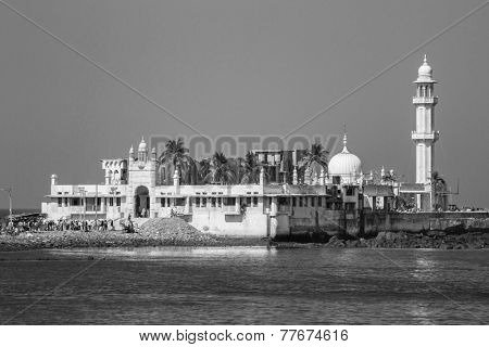 MUMBAI, INDIA - DECEMBER 12, 2012: Unidentified people at Haji Ali Dargah (Mosque) on December 12, 2012 in Mumbai, India. Mosque was built in 1431 in memory of a rich Muslim merchant.