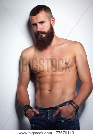 Portrait of handsome bearded man standing  isolated on grey