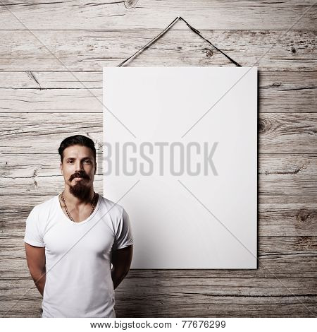 Bearded Man And White Banner On A Wood Wall