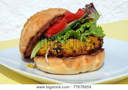 Veggie burger with salad.