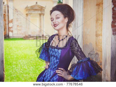 Beautiful Woman In Blue Medieval Dress Winking