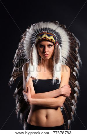 Beautiful woman in native american costume with feathers, isolated