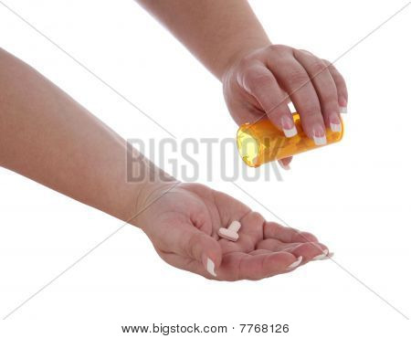 Woman Dispensing Pills into Hand