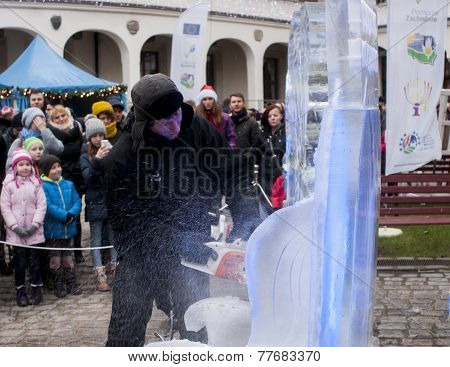 Unidentified Man Creating Artwork Out Of Block Of Ice.