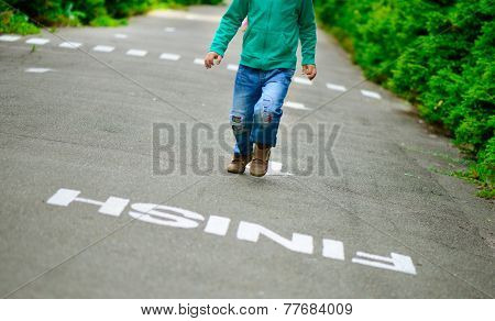 Little Boy Run On Footpath To The Finish Line