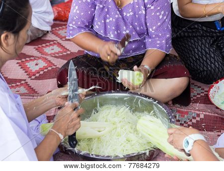People Slice Raw Papaya For Cooking Papaya Salad