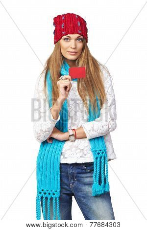 Winter woman showing blank credit card