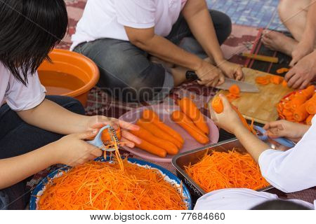 People Slice And Chop Carrot For Cooking Papaya Salad