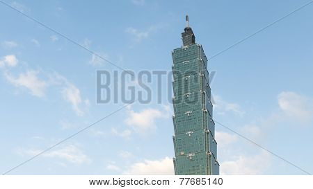 TAIPEI, TAIWAN - DECEMBER 6th : Famous Taipei 101 skyscraper with clouds moving in Taipei, Taiwan on December 6th, 2014.