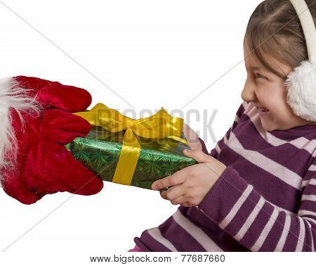 Little girl pulls Christmas gift of the hands of Santa