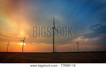 Rotating Wind Turbines At Sunset