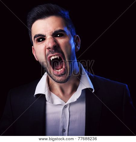 Scary Man With Black Eyes And Fangs