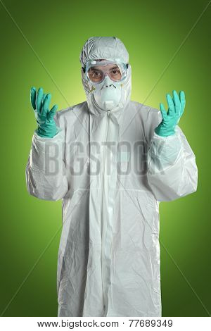 Scientist in Hazmat suit, goggles and gloves