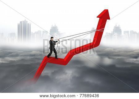 Businessman Control Arrow Direction Of Red Trend Line