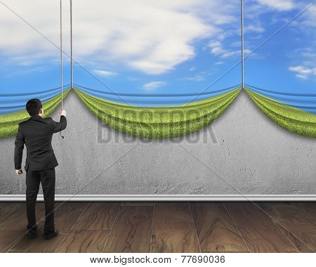Businessman Pulling Open Natural Sky Curtain Covered Concrete Wall