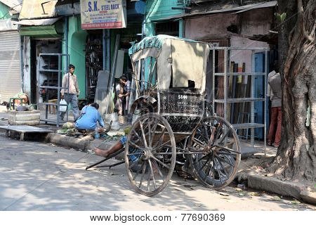 KOLKATA - FEB 12: rickshaw driver working on February 12, 2014 in Kolkata, India. Rickshaws have been around for more than a century, but they could soon be a thing of the past.