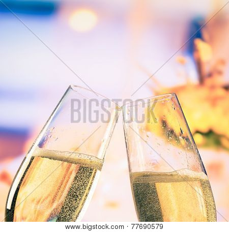 Champagne Flutes With Golden Bubbles On Flowers Background, Wedding And Valentine Day Concept