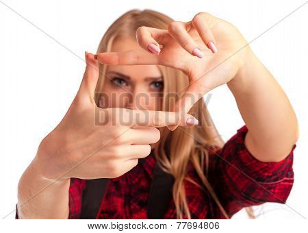 Female Photographer Making A Frame With Fingers