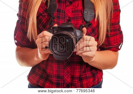 Female photographer holding a professional camera - isolated on