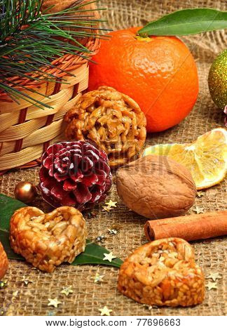 Christmas Tangerines With Dried Lemon, Walnuts, Pine Cones And Brittle Candies On Christmas Sacking