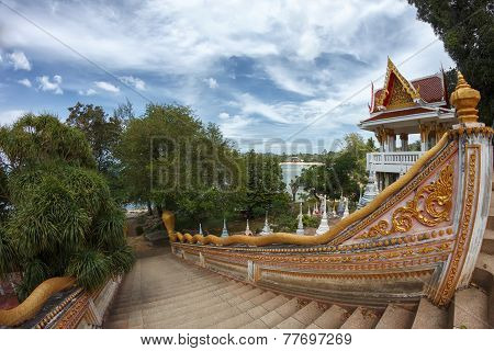 Ladder With Naga Decoration In A Traditional Buddhist Temple At The Seaside