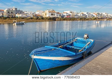 Traditional Portuguese Boat At The Dock. View Cabanas De Tavira.