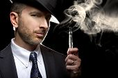 picture of vapor  - male smoking a vapor cigarette as an alternative to tobacco - JPG