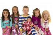 picture of pajamas  - Portrait of six children wearing winter pajamas - JPG