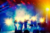 picture of sax  - ensemble playing night concert on the stage - JPG