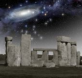 stock photo of stonehenge  - The monument of Stonehenge in front of a primordial deep space - JPG
