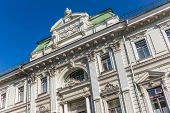 stock photo of neoclassical  - Beautiful neoclassic facade of the house on Iliynka street in Moscow old town Russia - JPG