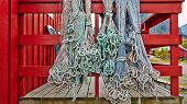 image of fishnet  - Fishing nets blue and green hanging on the fence or porch red fishnets carefully picked - JPG