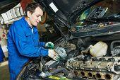 image of auto garage  - auto mechanic repairing automobile car engine turbine at maintenance repair service station garage - JPG