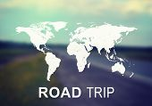 foto of continent  - World continents with inscription Road Trip and blurred panorama of empty road as backdrop - JPG
