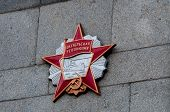 foto of communist symbol  - socialism symbol on a wall in the city of kharkiv in ukraine - JPG