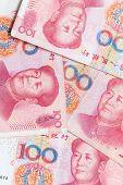 foto of yuan  - Modern Chinese yuan renminbi banknotes vertical photo background - JPG