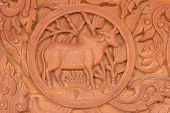 stock photo of oxen  - Wood carving of the ox Chinese zodiac animal sign - JPG