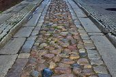 image of gutter  - Cobbled street from the gutter in Poznan