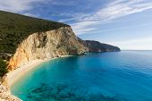 pic of rough-water  - beautiful beach with blue water and big mountain with rough cliffs - JPG