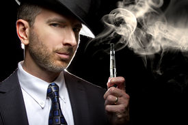 picture of tobacco smoke  - male smoking a vapor cigarette as an alternative to tobacco - JPG