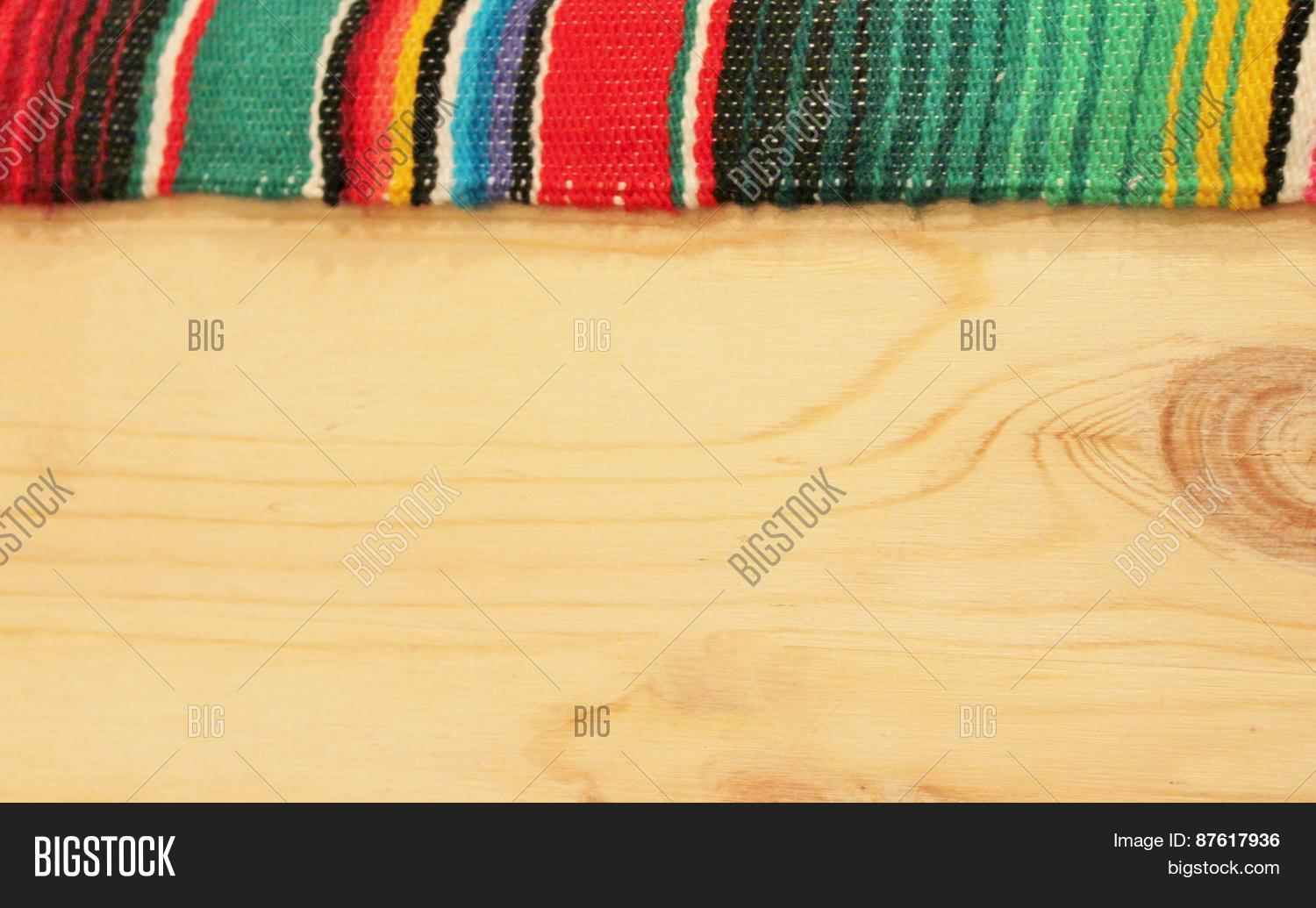 Fiesta mexican poncho rug bright image photo bigstock for Mexican themed powerpoint template
