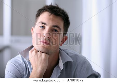 Man in  office with thoughtful look
