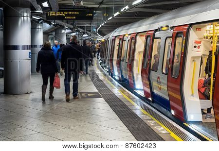 Passengers Boarding London Underground Train