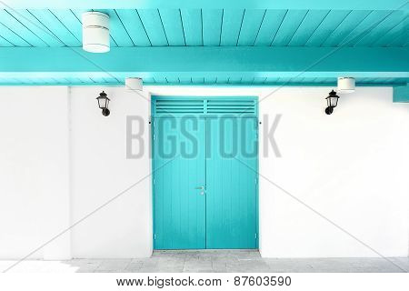 White wall with blue door and ceiling.