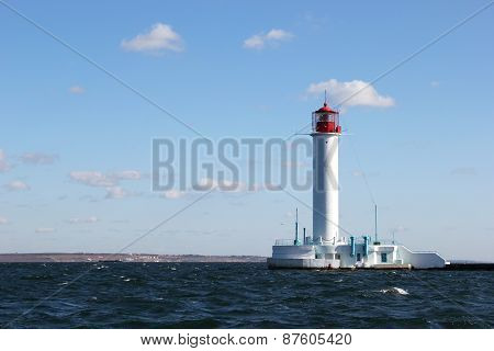 White Lighthouse In The Sea