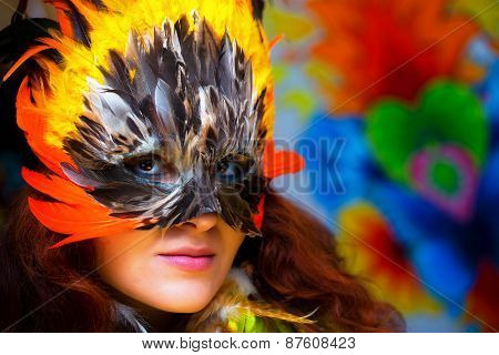 Venice mask with colorful decoration with color feathers