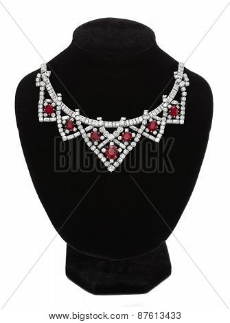 Pendant With Red Gem Stones On Black Mannequin Isolated On White