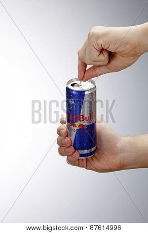 Kuala Lumpur,Malaysia 9th April 2015,Hand opening can of Red Bull Energy Drink isolated on white background.