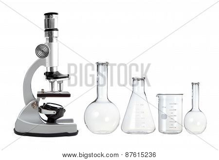 Laboratory Metal Microscope And Empty Test Tubes Isolated On White
