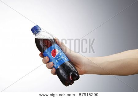 Kuala Lumpur,Malaysia 9th April 2015,Holding a can of Pepsi . Pepsi is a carbonated soft drink produced and manufactured by PepsiCo Inc. an American multinational food and beverage company.